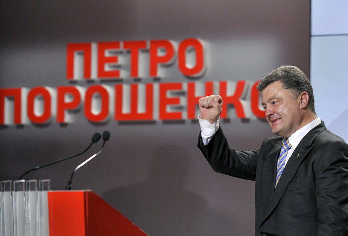 Ukrainian businessman, politician and presidential candidate Pyotr Poroshenko gestures to supporters at his election headquarters in Kiev May 25, 2014. (Reuters/Mykola Lazarenko)