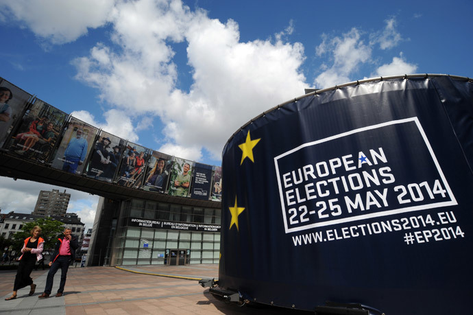 People walk in front of visuals promoting the European elections in front of the European Parliament in Brussels (Reuters / Eric Vidal)