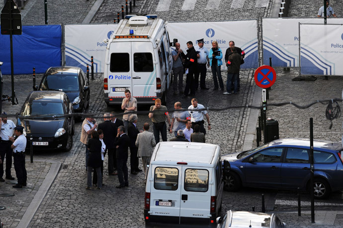 Police personnel are seen at the site of a shooting in central Brussels May 24, 2014. (Reuters / Eric Vidal)