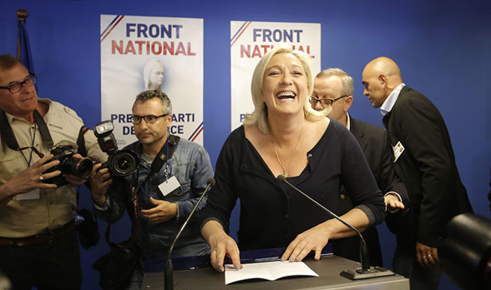 Marine Le Pen, France's National Front political party head, reacts to results after the polls closed in the European Parliament elections at the party's headquarters in Nanterre, near Paris, May 25, 2014. (Reuters / Christian Hartmann)