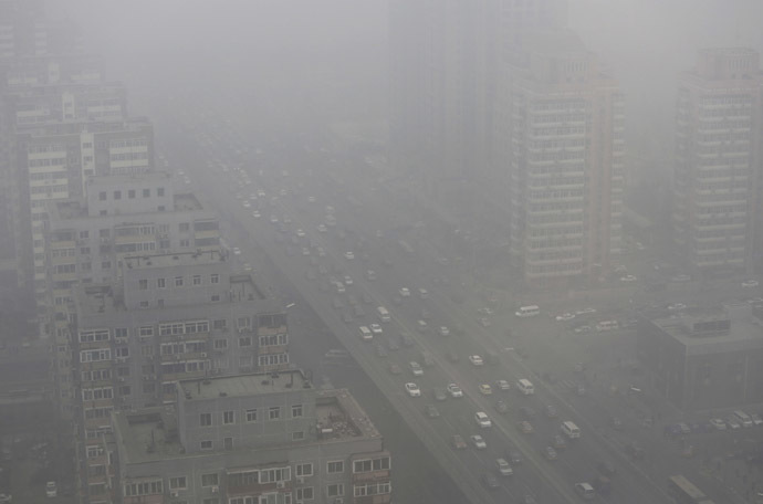 Cars drive on the Three Ring Road amid the heavy haze in Beijing February 26, 2014. (Reuters/Jason Lee)