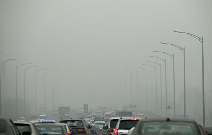 Cars travel on an overpass amid thick haze in the morning in Beijing February 26, 2014. (Reuters/Kim Kyung-Hoon)