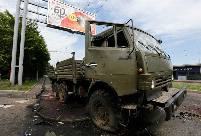 A wrecked Kamaz truck is seen near the Donetsk airport May 27, 2014. (Reuters / Yannis Behrakis)