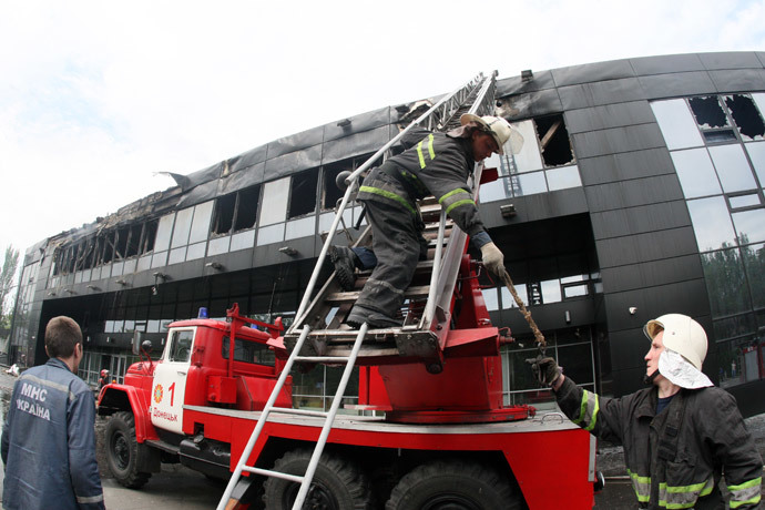 Firemen work on the damaged Druzhba Hockey Arena inthe eastern Ukrainian city of Donetsk, burned by unknown armed men, after they extinguished the fire on May 27, 2014. (AFP Photo / Alexander Khudoteply)