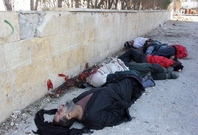 Bodies of handcuffed and blindfolded dead men lie on the ground of the Aleppo headquarters of the Islamic State of Iraq and the Levant (ISIL) after they were allegedly executed by the al-Qaeda-linked group, in the northern city of Aleppo (AFP Photo / Zakariya Al-Kafi)