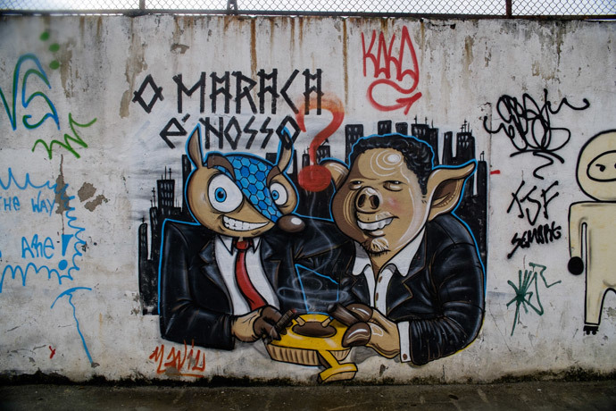 A graffiti depictingTatubola (L), the mascot of the upcoming FIFA World Cup, Tatubola, can be seen on a wall of the Maracana metro station, the nearest one to the Maracana stadium, during the restoration works ahead of the upcoming FIFA World Cup in Rio de Janeiro, Brazil, on May 28, 2014. (AFP Photo / Yasuyoshi Chiba)
