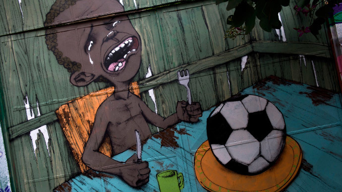 'Need food, not football': Brazilian graffiti art expresses outrage over World Cup (PHOTOS)