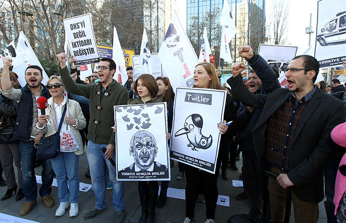 People hold placards as they protest against Turkey's Prime Minister Tayyip Erdogan after the government blocked access to Twitter in Ankara, on March 21, 2014. (AFP Photo / Adem Altan)