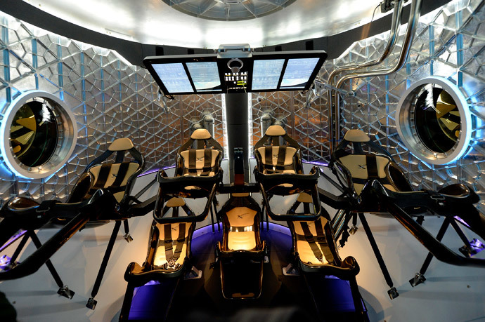 A view of inside the Dragon V2 manned capsule designed to carry astronauts after it was unveiled by SpaceX CEO Elon Musk during a news conference on May 29, 2014, in Hawthorne, California. (Kevork Djansezian / Getty Images / AFP)