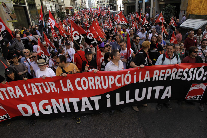 "Demonstrators of the General Confederation of Work (CGT) march during May Day celebrations in Valencia May 1, 2014. The banner reads, ""Against unemployment, corruption and repression. Dignity and struggle"". (Reuter/Heino Kalis)"