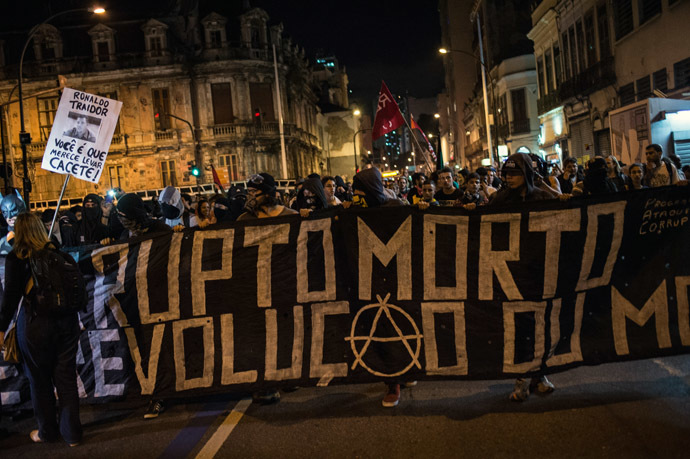 Members of the anarchist group Black Bloc protest against the FIFA World Cup in Rio de Janeiro, Brazil, on May 30, 2014. (AFP Photo/YASUYOSHI CHIBA)