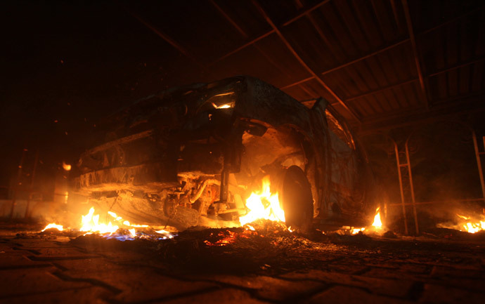 A burning car is seen at the U.S. Consulate in Benghazi during a protest by an armed group said to have been protesting a film being produced in the United States September 11, 2012.(Reuters / Esam Al-Fetori )