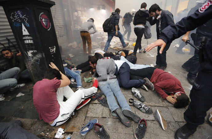 Anti-government protesters lie on the ground after riot police fired teargas to disperse them in central Istanbul May 31, 2014. (Reuters/Murad Sezer)