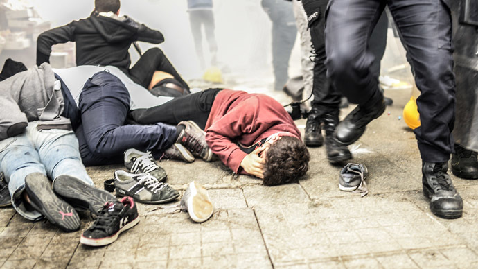 Tear gas, over 100 arrested as protesters mark 1 year ...