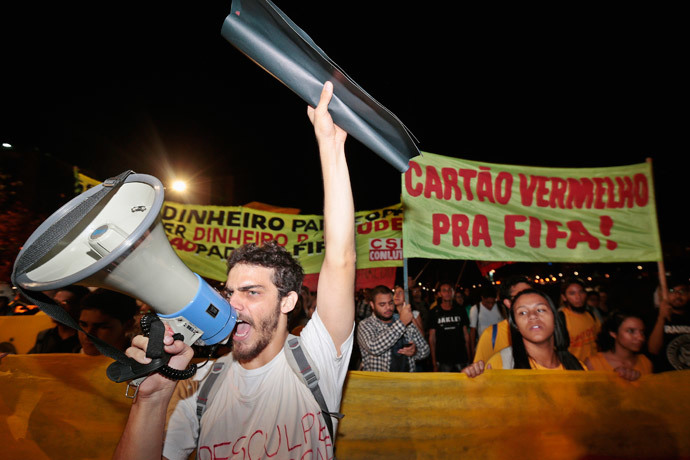 A man shouts through a megaphone during a protest against the money spent on preparations of the upcoming World Cup, in Brasilia May 30, 2014.(Reuters / Joedson Alves)