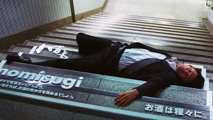 Sleeping drunks on streets of Japan turned into human billboards (VIDEO, PHOTOS)