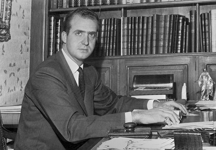Prince Juan Carlos of Spain (Juan Carlos Alfonso Víctor María de Borbón y Borbón) pictured at his desk in November 1975 in Madrid (AFP Photo)