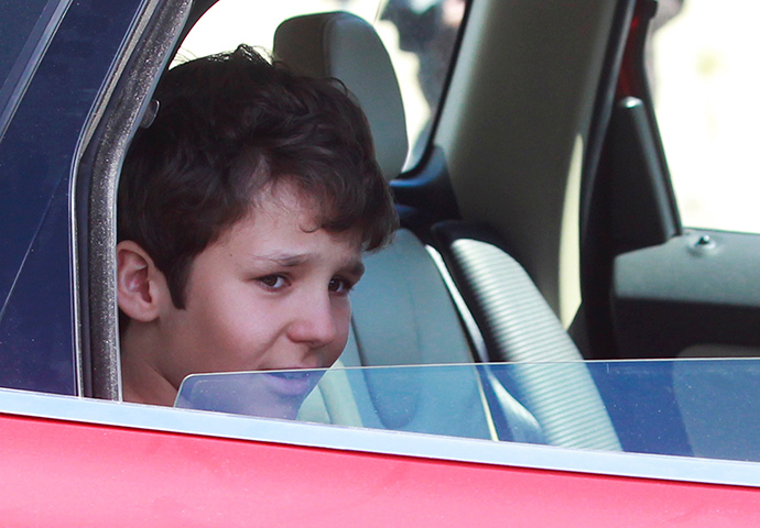 Felipe Juan Froilan, the 13-year-old son of the Spanish king's eldest daughter Infanta Elena, leaves a hospital after being discharged, in Madrid April 16, 2012 (Reuters / Stringer)
