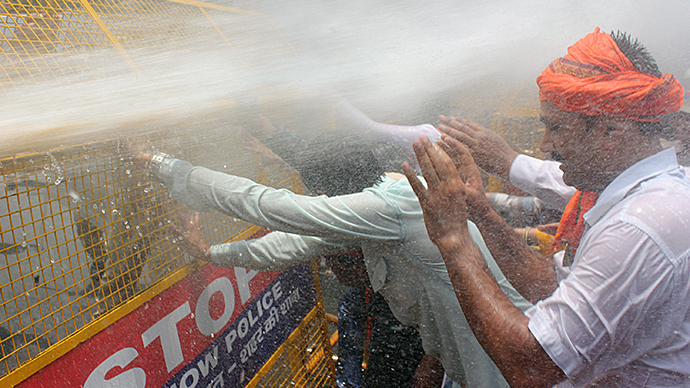 Water cannons deployed as hundreds in India protest gang-rape, killing of 2 teen girls