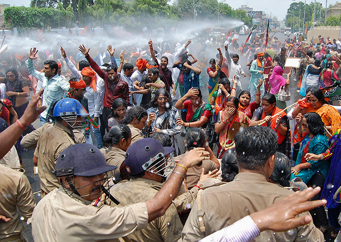 Supporters of Bharatiya Janata Party (BJP) shout slogans as police use a water cannon to stop them from moving towards the office of Akhilesh Yadav, the chief minister of the northern Indian state of Uttar Pradesh, during a protest against recent rape and hanging of two girls, in Lucknow June 2, 2014. (Reuters / Pawan Kumar)