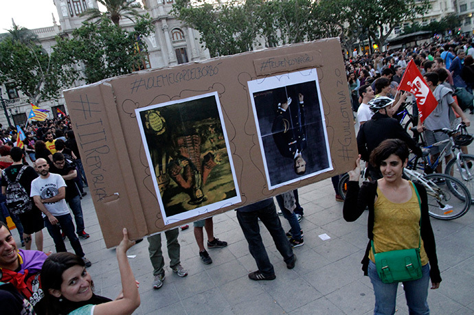 Protesters hold a placard with up-side-down portraits of Spain's first Bourbon King Felipe V (L) and Crown Prince Felipe during an anti-royalist demonstration at the town hall square in Valencia, June 2, 2014. (Reuters / Heino Kalis)