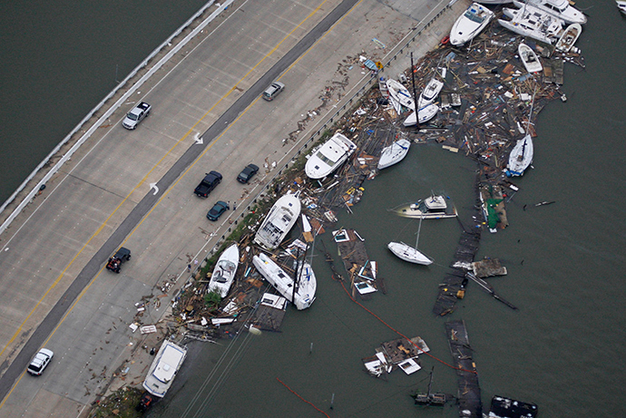 Boats are washed up next to a road after Hurricane Ike hit Clear Lake in Texas September 13, 2008 (Reuters / David J. Phillip)