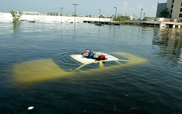 A police car is submerged in New Orleans East August 31, 2005 after Hurricane Katrina hit the area (Reuters)