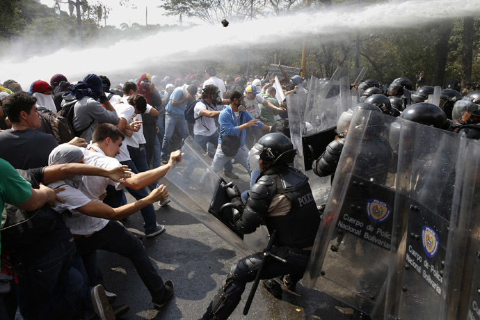 Anti-government protesters clash with police during a protest in Caracas March 12, 2014. (Reuters/Carlos Garcia Rawlins)
