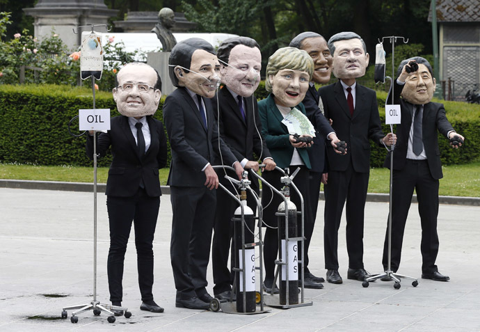 "Oxfam activists wear masks depicting leaders of the countries members of the G7 during a protest called ""Energy dependency and wealth inequality"" outside the European Council in Brussels June 3, 2014. (Reuters/Yves Herman)"