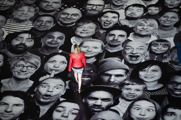 "A woman visits the exhibition ""Au Pantheon!"" by French photographer JR displayed on the ground of the Pantheon in Paris, a secular temple which contains the remains of distinguished French citizens, on June 3, 2014. (AFP Photo / Martin Bureau)"