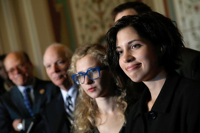 Nadya Tolokonnikova (R) and Maria Alyokhina (C), members of the Russian punk protest group Pussy Riot, answer questions after meeting with U.S. senators, including Sen. Ben Cardin (D-MD) (L) at the U.S. Capitol May 6, 2014 in Washington, DC. (Win McNamee / Getty Images / AFP)