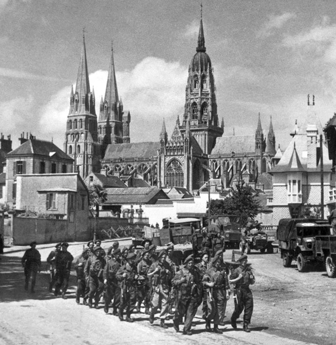 British soldiers march past the town of Bayeux, one of the first towns to be liberated in the Normandy landings. (AFP Photo)