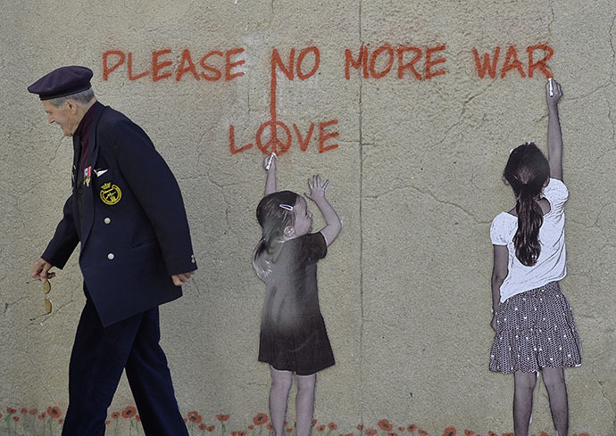 ": An 88-year old British D-Day veteran Paul Butler passes along a wall mural at Arromanches-les-Bains on the Normandy coast with a graffiti saying ""Please, no more war"" (Reuters / Toby Melville)"