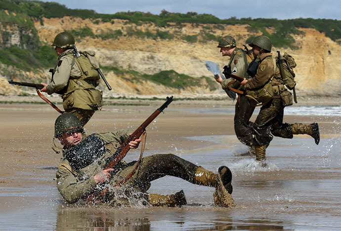 History enthusiasts wearing WW2 US military uniforms in D-Day landing re-enactment on Omaha Beach in Vierville-Sur-Mer, on the Normandy Coast on June 5 2014. (Reuters / Pascal Rossignol)