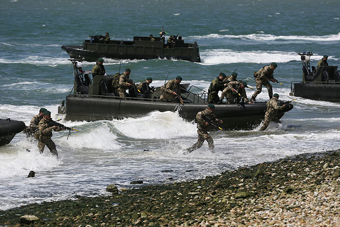Royal Marines take part in a display during a D-Day event in Portsmouth June 5, 2014. (Reuters / Stefan Wermuth)