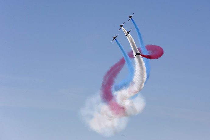 The UK's Royal Air Force aerobatic team, the Red Arrows, perform during D-Day celebrations in Portsmouth on June 5 2014. (Reuters / Stefan Wermuth)