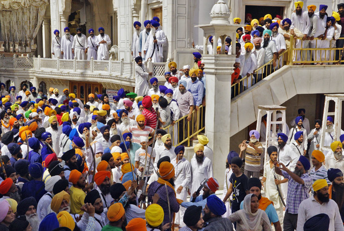 Sikhs gather during their clash inside the complex of the holy Sikh shrine, the Golden Temple, in the northern Indian city of Amritsar June 6, 2014. (Reuters/Munish Sharma)