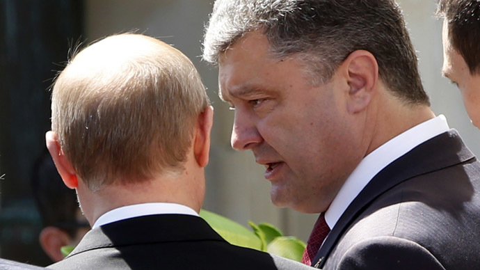 Putin hails Poroshenko's 'positive thinking' on settling crisis after D-Day meeting