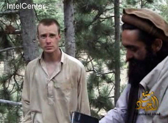 This still image provided on December 7, 2010 by IntelCenter shows the Taliban associated video production group Manba al-Jihad December 7, 2010 release of US Sergeant Bowe Bergdahl (L), who has been held hostage by the Taliban since his disappearance from his unit on June 30, 2009. (AFP Photo)