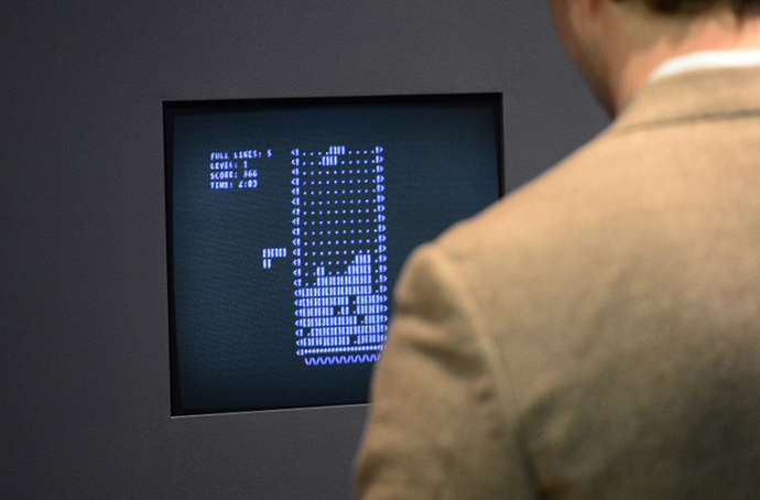 A visitor plays the video game Tetris (1984) during an exhibition preview featuring 14 video games acquired by The Museum of Modern Art (MoMA) in New York (AFP Photo / Emmanuel Dunand)