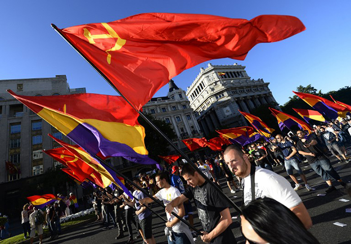 People hold flags of the Spanish Second Republic and communist flags during a demonstration to demand a referendum on the monarchy following the abdication of King Juan Carlos, in Madrid on June 7, 2014. (AFP Photo / Gerard Julien)