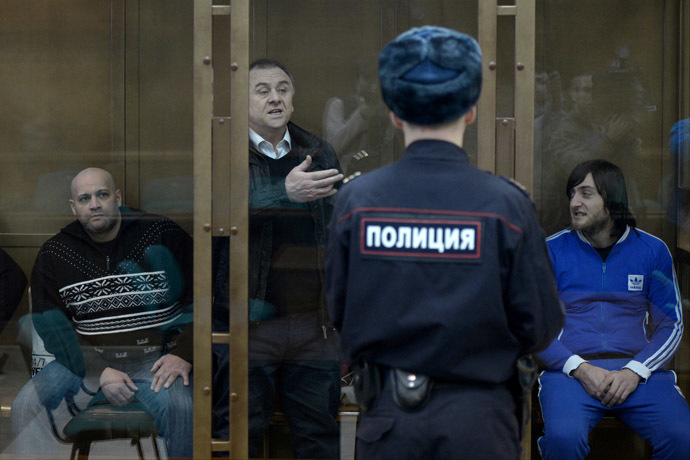 From left: Sergei Khadzhikurbanov, Lom-Ali Gaitukayev and Ibragim Makhmudov, defendants in the Novaya Gazeta columnist Anna Politkovskaya murder case, during trial in the Moscow City Court. (RIA Novosti/Evgeny Biyatov)