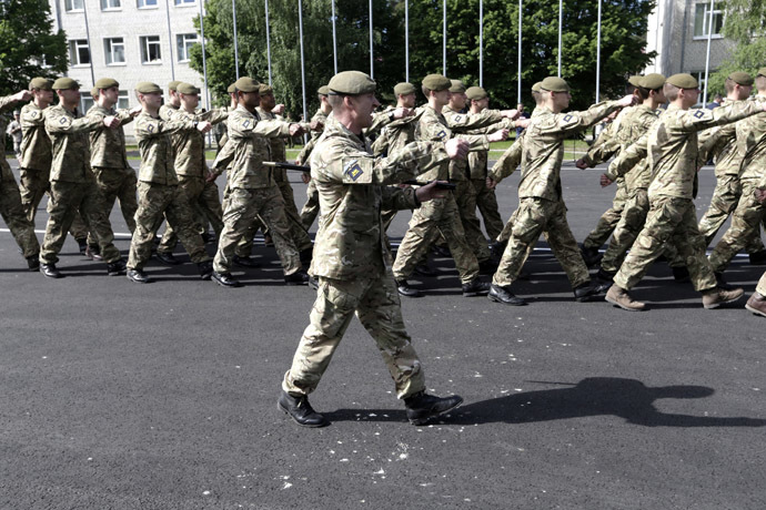 "Britain's army soldiers march during opening ceremony of NATO military exercise ""Saber Strike"" in Adazi June 9, 2014. (Reuters/Ints Kalnins)"