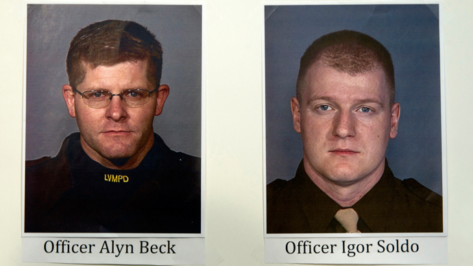 Photos of slain Metro Police officers Alyn Beck and Igor Soldo are displayed during a news conference at Metro headquarters following the death of the two officers and a citizen in Las Vegas June 8, 2014 (Reuters / Steve Marcus)