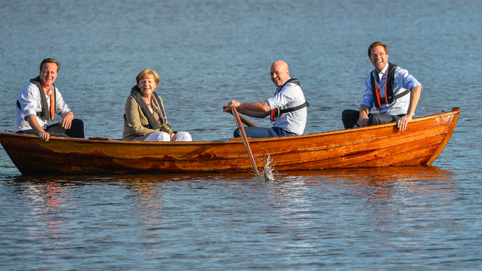 (L-R) British Prime Minister David Cameron, German Chancellor Angela Merkel, Swedish Prime Minister Fredrik Reinfeldt and Dutch Prime Minister Mark Rutte sit in a punt with Reinfeldt handling the oars in a lake at Reinfeldt's summer residence Harpsund, southwest of Stockholm June 9, 2014, during an evening break in their talks on EU and the new European Parliament (Reuters / Anders Wiklund)