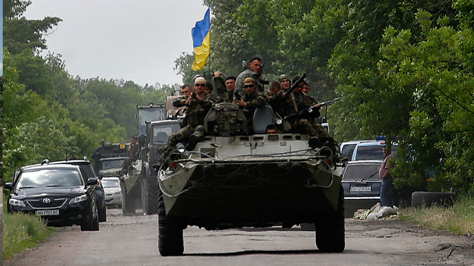 Ukrainian soldiers ride atop an Armored Personnel Carrier (APC) in eastern Ukrainian town of Volnovakha, south of Donetsk (Reuters / Yannis Behrakis)