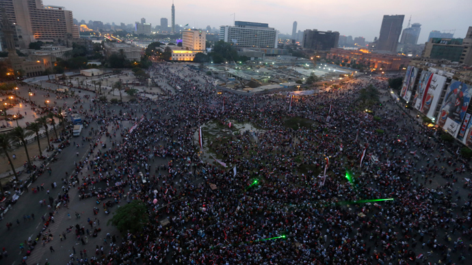 Egyptians celebrate after the swearing-in ceremony of President elect Abdel Fattah al-Sissi in Tahrir square in Cairo, June 8, 2014 (Reuters / Mohamed Abd El Ghany)