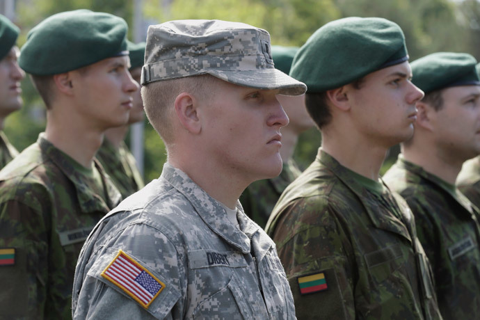 "A U.S. soldier attends the opening ceremony of NATO military exercise ""Saber Strike"" with Lithuanian soldiers, in Adazi, Lithuania. June 9, 2014.(Reuters / Ints Kalnins)"