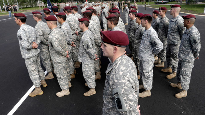"U.S. army paratroopers attend opening ceremony of NATO military exercise ""Saber Strike"" in Adazi, Lithuania. June 9, 2014. (Reuters / Ints Kalnins)"