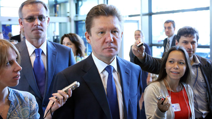 Gazprom Chief Executive Officer Alexei Miller is surrounded by reporters as he arrives for an EU-Russia-Ukraine trilateral energy meeting at the European Commission headquarters in Brussels June 11, 2014.(Reuters / Francois Lenoir)